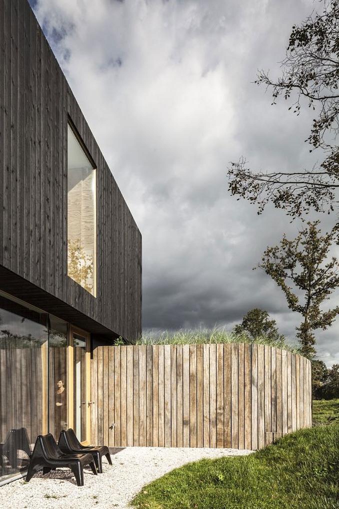 Wooden wall in Modern Villa V by Paul de Ruiter Architects