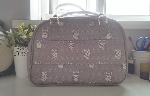 An owl print cabin bag from New Look