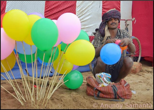 Busy Balloon Seller over the Beach