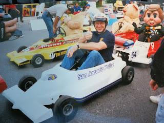 Philippus rides a go-cart police car.