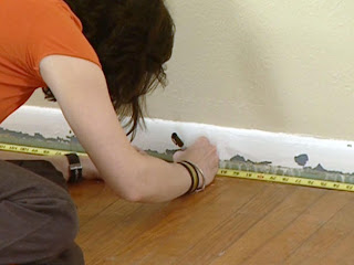 lady measuring for carpeting installation