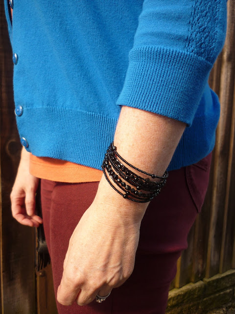 Close up of Black Bead Cuff & Cobalt Cardigan  | Petite Silver Vixen