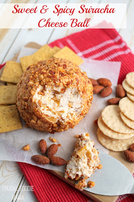 This Sweet & Spicy Sriracha Cheese Ball is the perfect combination of sweet & spicy with its roasted, crunchy sriracha almonds, sweet dried apricots, and an added extra kick of heat from a little sriracha sauce. #ad