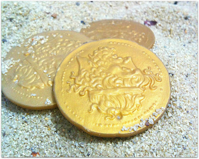gold coins found in the sand