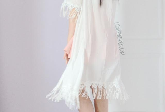 SheIn's white tassel-trim longline kimono, worn with a pastel pink skater skirt.