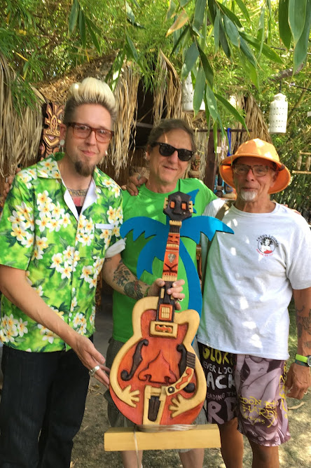 I sold this guitar tiki to Jack, on the right.