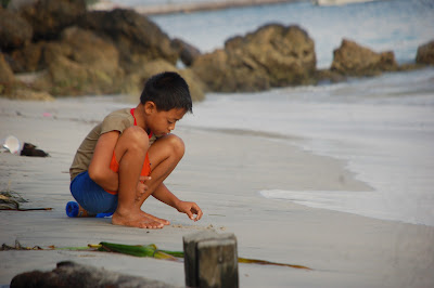 Nusa Penida Boy, write on the Beach