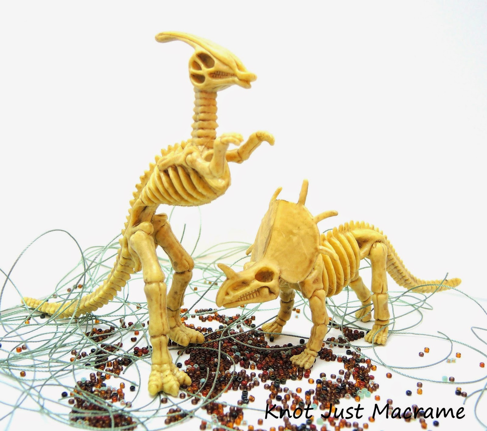 Dinosaur skeletons playing in beads and cord.