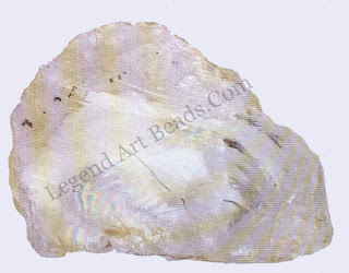 QUARTZ- The structure of quartz is based on a strongly bonded, three-dimensional network of silicon and oxygen atoms. Crystals do not cleave easily but show a rounded, concentric fracture known as conchoidal.