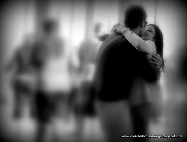 black and white photo of lovers in Venice. Camera used: Panasonic Lumix FZ35