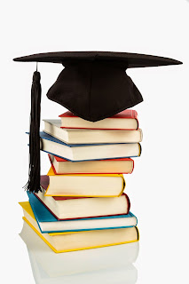 Pile of books with a graduation cap on top