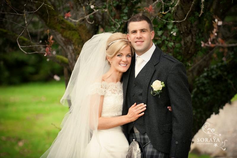 Spring wedding at Achnagairn House in the Highlands of Scotland. bride wearing a full veil and soft romantic updo