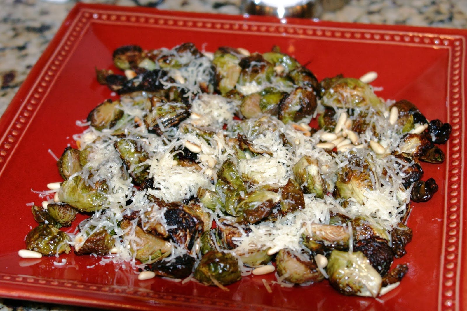 ... Brussels Sprouts with Caramelized Onions, Crispy Bacon, and Pine Nuts