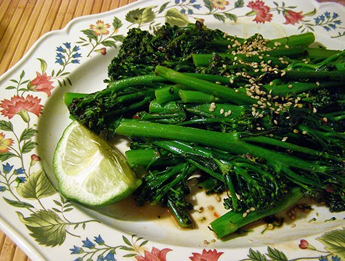 Plate of Sesame Lime Broccolini Garnished with Lime