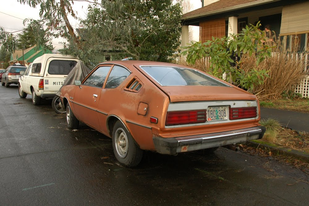 OLD PARKED CARS.: 1977 Plymouth Arrow 160 Hatchback.