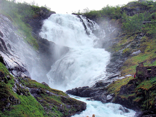 Beware of the Huldra who dwell in these sylvan lands! Here's a shot of Kjosfossen (Kjos Waterfall)and if you look carefully, you can see these mysterious sirens at the right center of the picture.