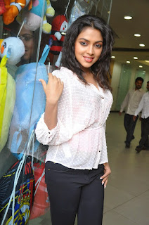 Amala Paul looks so cute and lovelyin Transparent White Top and Black Trousers
