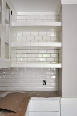craftsman bungalow renovation. beveled subway tile backsplash with dark grout