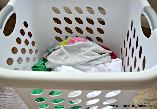 sorting kids laundry in baskets