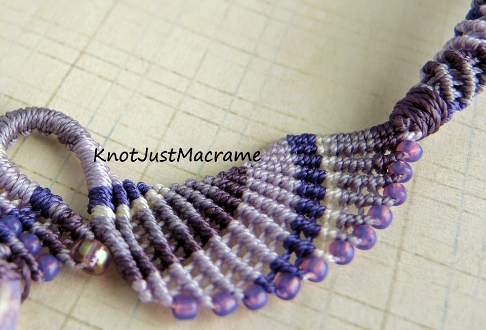 Close up of micro macrame in purples.