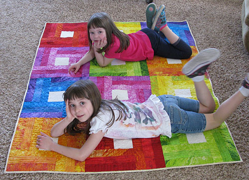 Rainbow quilt with my granddaughters on it