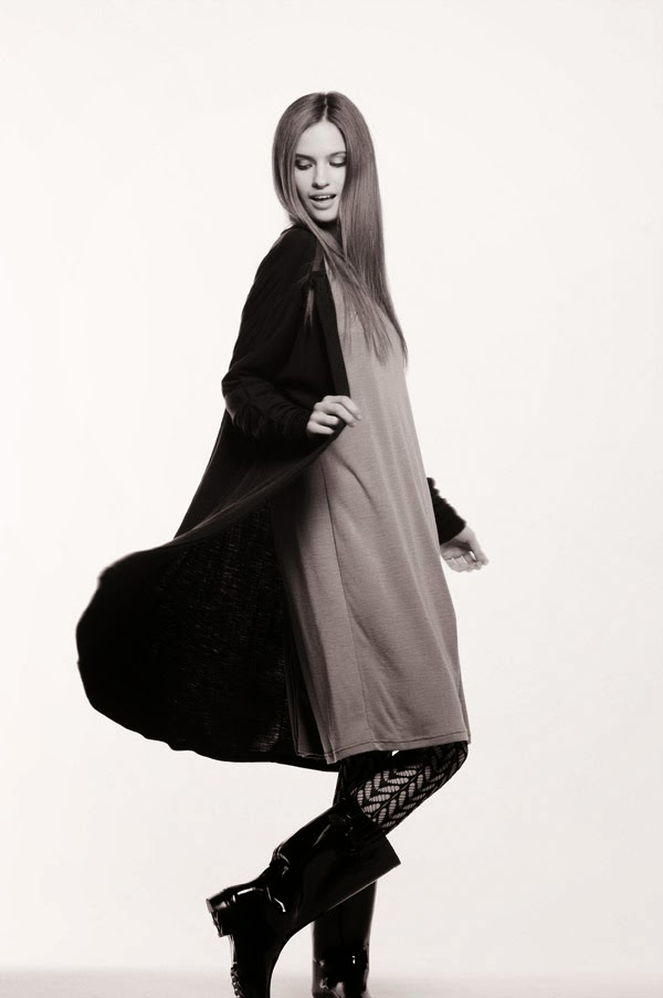 Action shot, Gumboots with Comodo Wool Buttoned Tunic - Women's Fashion, White Background Studio Photography by Kent Johnson.