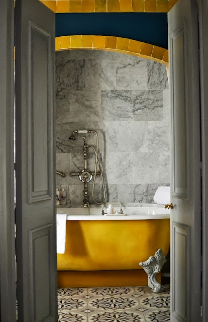 grey and yellow bathroom with beautiful claw foot bathtub