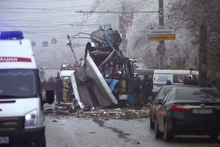 Forensic experts and police officers at the site of a trolleybus explosion in Volgograd, Russia