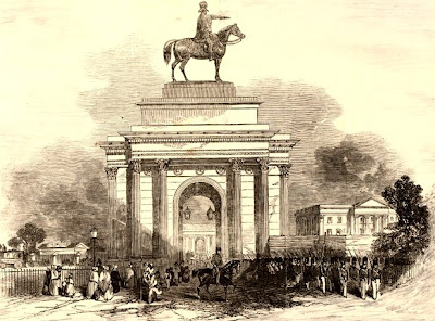 The Triumphal Arch near Hyde Park from Constitution Hill  with large equestrian statue of the Duke of Wellington on top  Wood engraving, prob by E Landells,  from Illustrated London News 15 August 1846  © The Trustees of the British Museum