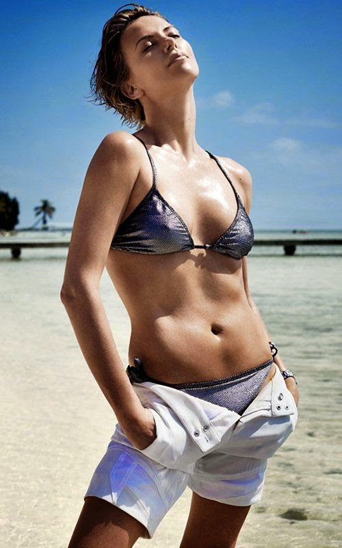 Sure enough, the 38-year-old looks pretty content in a grey bikini for June 2014 edition of Vogue Magazine after her lengthy trip for Mario Testino camera on Thursday, March 20, 2014.