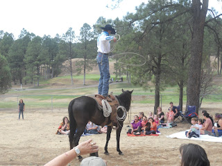 cowboy standing on horse, spinning lasso