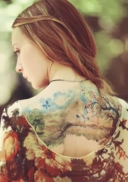 Unbelievable beautiful upper back tattoo!