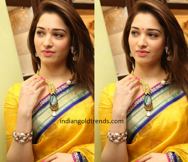 Tamanna in Unique Designer Emerald Gold Necklace