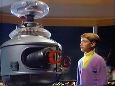 Will Robinson and the Robot in Lost In Space 1965 movieloversreviews.blogspot.com