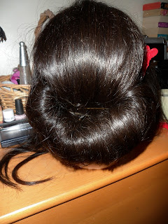 Roll your hair into a Chignon  updo