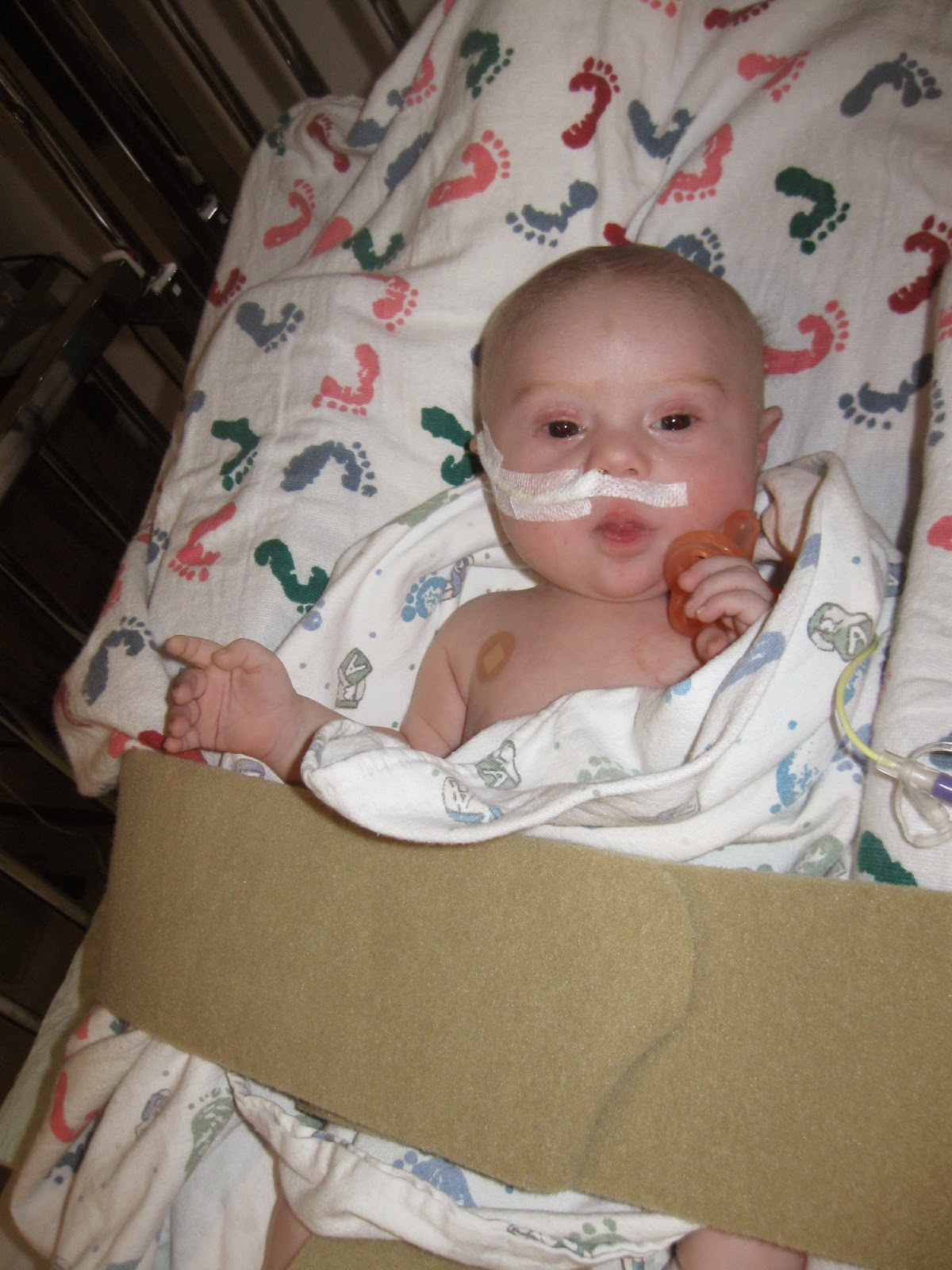 Jacob in the hospital with heart failure. His heart meds created severe reflux and he had to get a tube put into his intestines so that he could keep food down.
