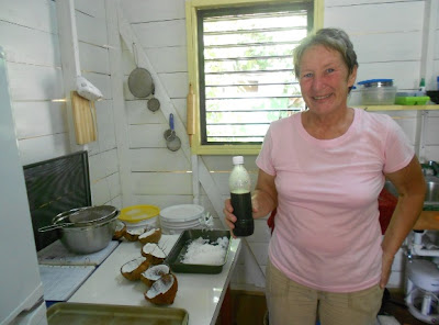 Showing off her Noni Juice and Coconut shavings in Belize with McKinley Pritchard