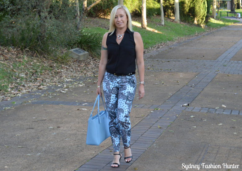 Blue Printed Pants, Black Sleeveless Shirt, Light Blue Tote, Black Sandals