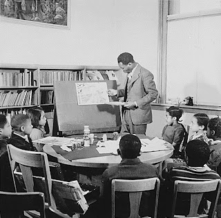 Jacob Lawrence teaching school children at the Abraham Lincoln School.