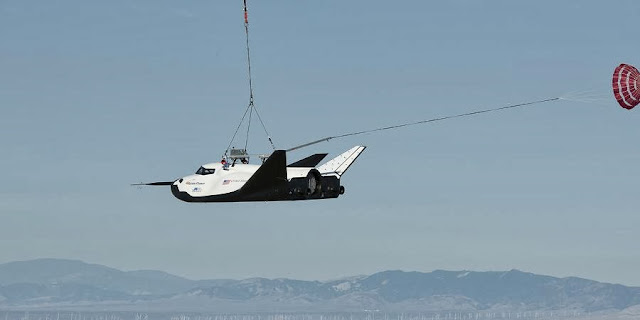 An Erickson Air-Crane helicopter lifts Sierra Nevada Corporation's Dream Chaser flight vehicle during a captive-carry flight test on Aug. 22, 2013. Credit: NASA/Carla Thomas