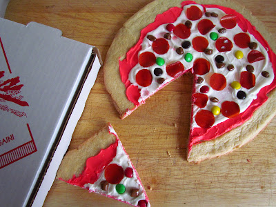 overhead shot of cookie pizza that looks like a pepperoni pizza