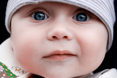 Cute baby girls with blue eyes