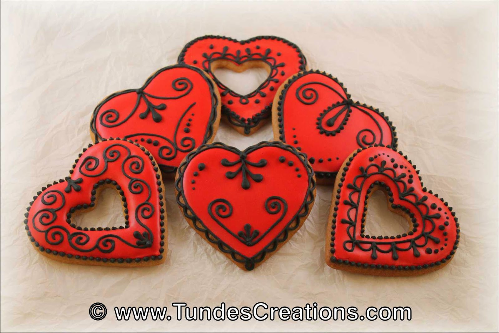 Red and black traditional Valentine's gingerbread hearts.