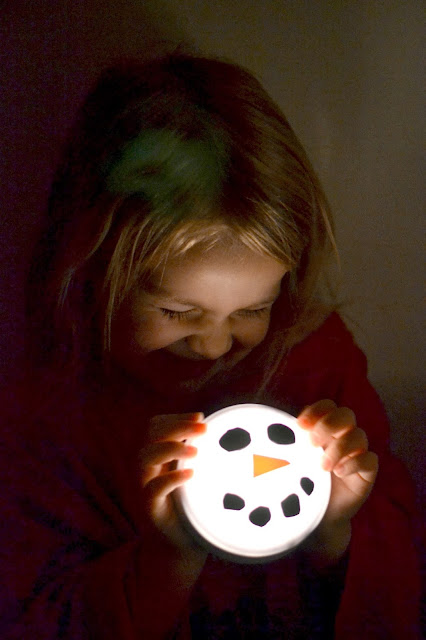 Tap lights turned snowmen- a fun craft for kids that doubles as a nightlight