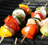Grilling shishkabobs with chicken and vegetables