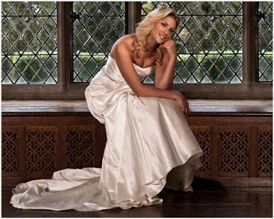 Redworth Hall beautiful bride sits in window