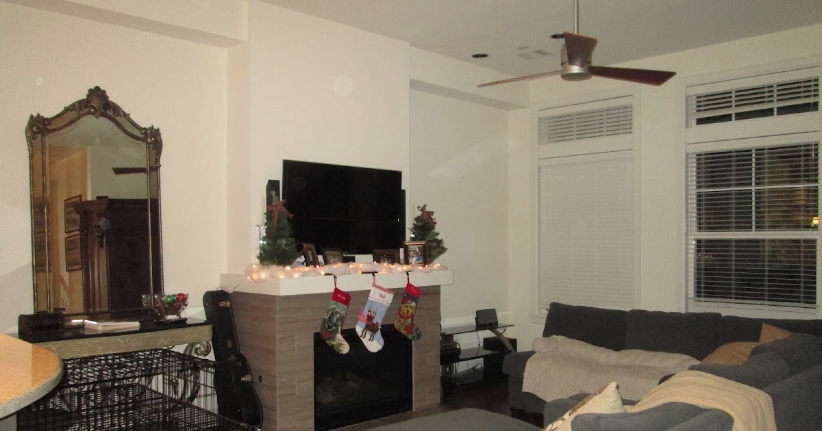 Tight Living Room With Tv Hanged On The Wall