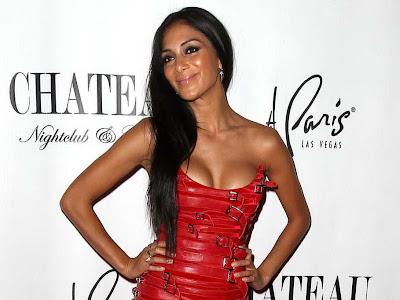 Nicole Scherzinger in tight red leather dress