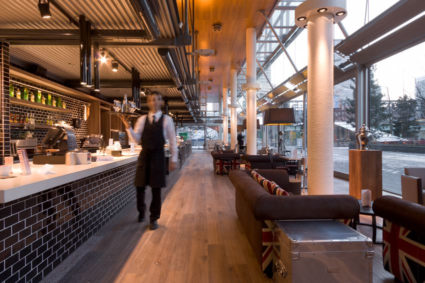 what i love most in the space is the the industrial modern bar with black subway tile and corrugated metal overhang