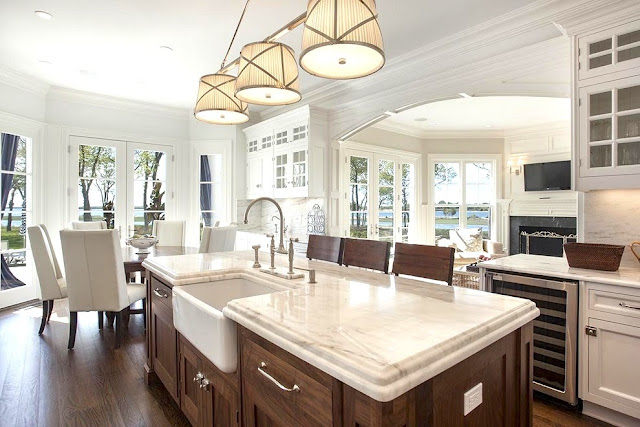 Kitchen bay window island with wood cabinets farmhouse sink Sag Harbor home
